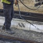 Road worker spraying manually bitumen emulsion 2 — Stock Photo #69060833