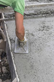 Concrete leveling with trowel — Stock Photo