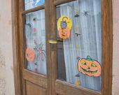 Children's drawings in a nursery window — Stock Photo