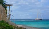 Sailboat on azure seas — Stock Photo