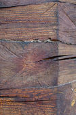 Knot on a log house detail vertical closeup. — Stock Photo