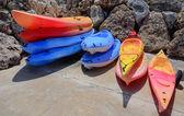 Stacks of colorful kayaks — 图库照片