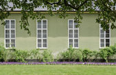 Green neoclassical building exterior — Stock Photo