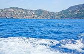 Ocean landscape with boat seafoam — Stock Photo