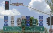 Road signs at a crossroad on Route 66 — Stock Photo