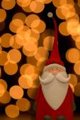 Santa Claus with golden lights in the background — Stock Photo