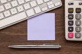 Blank purple paper on workspace for note — Stock Photo