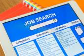Digital tablet pc showing user interface of online job search — Stock Photo
