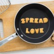 Постер, плакат: Letter biscuits word SPREAD LOVE and cooking equipments