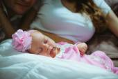 Image cute little girl on lap of young mother. Mum and baby — Foto Stock