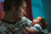Image of young dad with cute little daughter in his arms — Stock Photo
