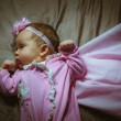 Image of cute little girl in pink suit and cloak indoor — Stock Photo #55111233