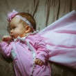 Image of cute little girl in pink suit and cloak indoor — Stock Photo #55111251