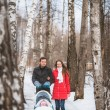 Young family walk in winter wood. Parent pulling sledge — Stock Photo #68166149