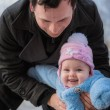 Smiling baby on father hands. Happy infant girl while Hiking in winter — Stock Photo #68166183