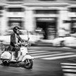 Man Riding Motorcycle at the Street of Rome — Stock Photo #56500273