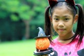 Close up portrait of Asian girl hold pumpkin doll — Stock Photo
