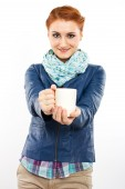 Young red-haired girl with a cup of hot coffee — Stock Photo