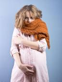 Beautiful pregnant blonde in a warm brown scarf. Portrait of a young pregnant woman — Stock Photo