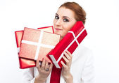 Young girl in red dress with gift red box. Beautiful red-haired girl on white. — Stock Photo