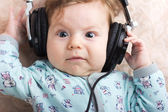 Funny baby in a big headphones. Portrait of a little boy. Cute child. — 图库照片