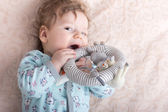 Beautiful baby with a lovely toys.The child in the crib — Stock Photo