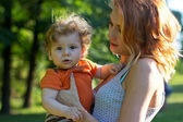 Young mother walking with a little boy. Child Outdoors.Mother and baby walk — Stock Photo