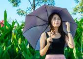 Girl smilling with hold umbrella   — Stock Photo