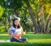 Beautiful pregnant asian woman show image of the baby — Stock Photo