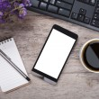 Working table with smart phone note paper pen flowers and cup of — Stock Photo #71672817
