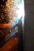 Welding steel with spread spark lighting smoke — Stock Photo