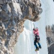 Woman mountaineer climbs on vertical icefall — Stock Photo #67082111