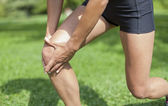 Knee pain during sports activity — Stock Photo
