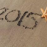 Starfish next to 2015 written on sand — Stock Photo #59227839