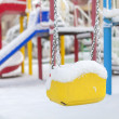Snow covered swing and slide at playground in winter — Stock Photo #62103721