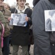 Постер, плакат: People hold portraits of Boris Nemtsov at the rally dedicated to his murder Voronezh Russia