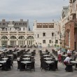 Waiters lay the tables of the restaurant at Piazza Square, Batumi, Georgia. — Stock Photo #70599617