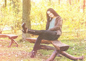 Young pretty woman in autumn park young — Stock Photo