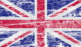 Flag of United Kingdom with old texture. Vector — Stock Vector