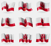 Set of Gibraltar flags in the air. Vector — Stock Vector