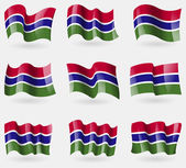 Set of Gambia flags in the air. Vector — Stock Vector