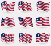 Set of Liberia flags in the air. Vector — Stock Vector