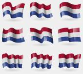 Set of Netherlands flags in the air. Vector — Stock Vector