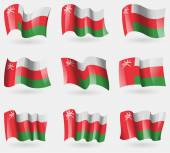 Set of Oman flags in the air. Vector — Stock Vector