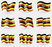 Set of Uganda flags in the air. Vector — Stock Vector