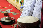 Folk musical drum cymbals and books — Stock Photo