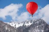 Balloon over winter landscape — Stock Photo