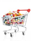 Pills in a supermarket shopping trolley — Stock Photo