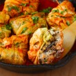 Stuffed cabbage rolls with rice and mushrooms in tomato sauce. Dolma, sarma, or golubtsy - traditional dish of many countries — Stock Photo #51815229