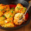 Stuffed cabbage rolls with rice and mushrooms in tomato sauce. Dolma, sarma, or golubtsy - traditional dish of many countries — Stock Photo #51815309